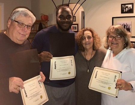 Group of people certified in Reiki holistic healing in Ocean Township, NJ.